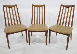 Six 1970's G-Plan teak railback dining chairs with beige leatherette seats, h. 44cmsCondition