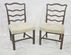 Set of eight 20th century mahogany Georgian-style dining chairs with shaped ladder backs, on moulded