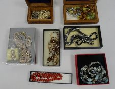 Carved hardwood box and contents including cloisonne enamel beads and other items of costume
