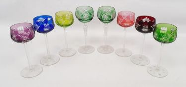 Set of six harlequin coloured hock glasses and two further (8) together with a tray of flatware