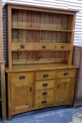 Modern pine dresser, the plate rack fitted with three open shelves and three short drawers, the base