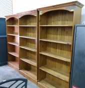 Set of three tall pine open bookcases each with stepped cornice over five open shelves, 92cm wide