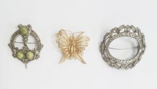 A gold coloured filigree brooch of a butterfly, a Celtic style brooch and a paste buckle/brooch (3)