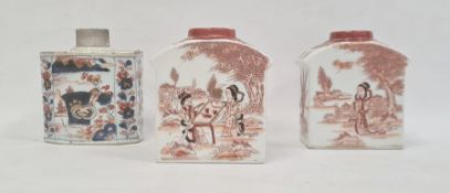 Porcelain tea caddy with floral decoration in Imari colours, 11cm high and a pair of porcelain tea