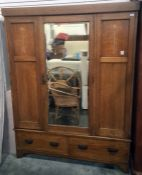Early 20th century oak wardrobe with central mirror door flanked by decorative art nouveau inlaid