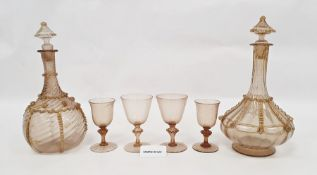 Suite of Venetian glass to include two decanters with gilt decoration, 18 larger wine glasses and 16