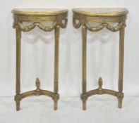 Pair of reproduction gilt wood and marble console tables, each of demi-lune design, decorated with