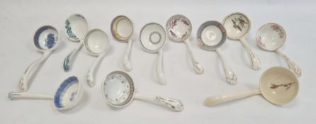 Large quantity of Victorian and later pottery sauce ladles, variously floral, geometric and