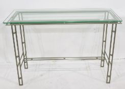 Modern glass and metal console table, the metal rod base with ball decoration and with rectangular