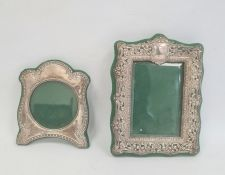 Edwardian silver mounted rectangular photograph frame, repousse and pierced scroll decoration,