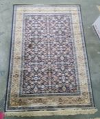 Blue ground Kashmiri allover design rug, 170 x 118cm