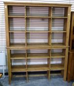 Two pine shelving units each with two open shelves and two upright divisions, 160cm wide x 104cm