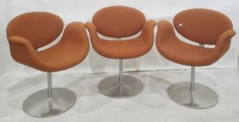 Three Artifort tulip chairs by Pierre Paulin upholstered in orange fabric on revolving aluminium