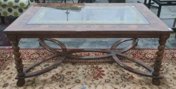 Modern rectangular oyster walnut and glass-topped coffee table on barleytwist and carved supports,