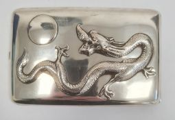 Chinese silver cigarette case, rectangular and curved, the hinged lid repousse with dragon chasing