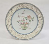 Chinese porcelain shallow dish with pierced border, the centre painted in enamel with