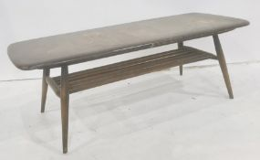 Dark elm Ercol coffee table with magazine rack under, 105cm x 36.5cm Condition ReportNumerous