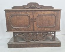 20th century oak sideboard, the rectangular top with rounded front corners, moulded and carved edge,