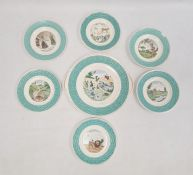 French pottery nursery setof six tea plates and one larger bread and butter plate, all variously
