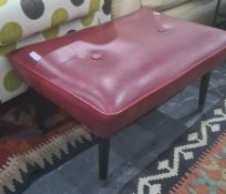 1970's red footstool on tapering supports