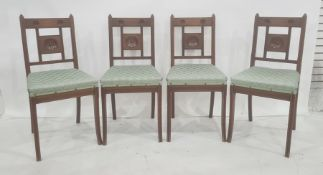 Four Edwardian oak dining chairs, the bar backs and central panel decorated with circular and reeded