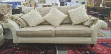 Lee Longlands three-seater sofa and matching chairin diamond-patterned upholstery, with brown