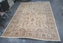 Modern light gold ground foliate design rug, 299 x 214cm