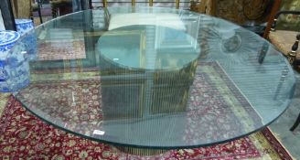 Modern centre tablewith central metallic cylindrical base and circular plate glass top, 153cm