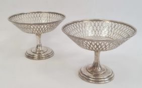 A pair Asprey & Co. silver pedestal bonbon dishes, pierced bowls on circular bases, Birmingham 1915,