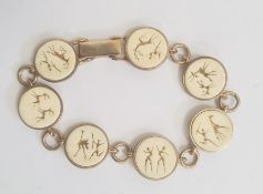 South African 9ct gold and ivory bracelet, seven circular ivory mounts depicting hunting scenes,