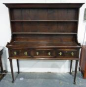 Georgian dresser, the base possibly fruitwood, fitted with three short pine-sided drawers over