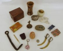Two trays of assorted items to include table lighter, trinket box, carved egg, etc (2)