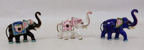 Three 20th century enamel modelsof elephants, each 6cm high (3)