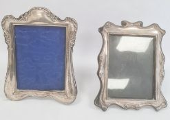 Edwardian silver mounted photograph frame, rectangular with scroll and floral repousse detail,