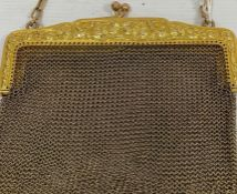 A 9ct gold chain purse,foliate decoration to clasp, 118g approx.Condition Reportsee image it is as