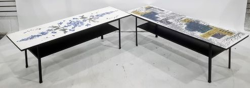 Two mid century coffee tables, the rectangular tops with printed decoration, on black-coloured