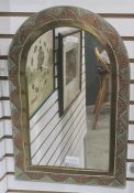 Metal wall mirror of rectangular form with arched top, the frame with tri-colour copper, brass and