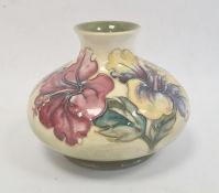 Moorcroft pottery vaseof squat baluster form, tube-lined floral decoration on a yellow and green