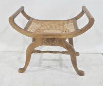 Cane seated stoolon mahogany and saltire stretchered base
