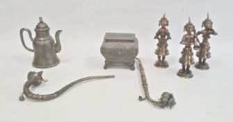 Set of three white metal figuresof musicians, the costume of each adorned with bells, approx 18cm