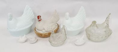 Assorted glass hen egg crocks and one porcelain example