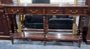 Modern hall table, the rectangular top with four drawers, raised on turned and reeded supports,