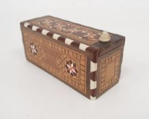 Anglo Indian inlaid boxed set of miniature dominoes with geometric inlaid decoration Condition
