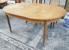 1970's G-Plan style teakextendingdining tableof oval form on tapering circular supports, 112 x