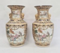 Pair of Chinese porcelain vases, each angular baluster shape and painted in panels with hunting