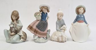 Lladro group of girl washing a dog, another model of rabbit, another cow, seated and swan with