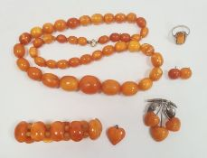 Graduated butterscotch amber beaded necklace, 60.9g approx, largest bead 2.5cm x 2cm approx,