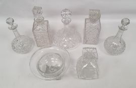 Assorted decanters and pedestal bowl with grape and vine decoration, square base