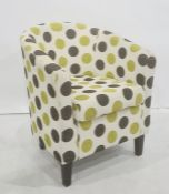 Modern green and black spotted tub chair