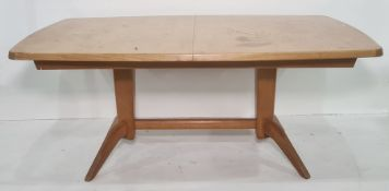 20th century Gordon Russell extending dining tableon twin pedestal base united by stretcher
